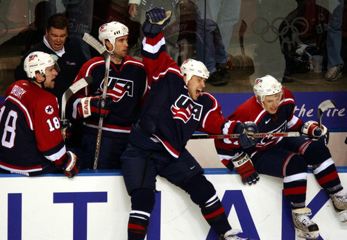 |  Tribune file photo The USA bench reacts after time runs as the USA beats Russia 2-3 to advance to the men's hockey gold medal game during the 2002 Salt Lake Games.