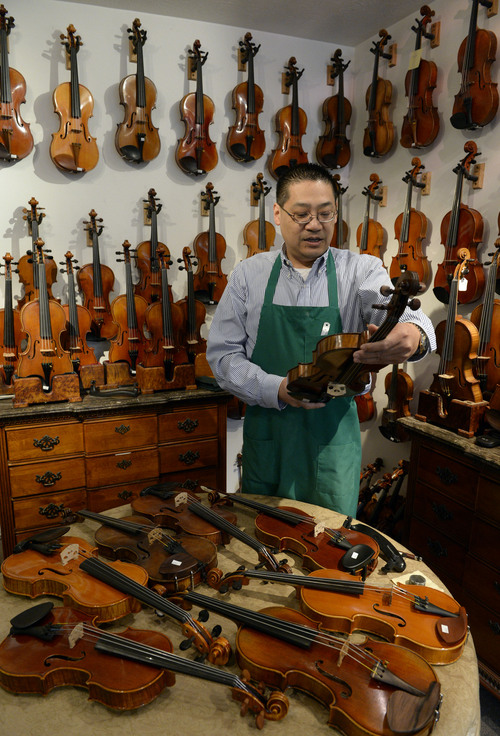 Francisco Kjolseth  |  The Salt Lake Tribune Charles Liu has been making fine violins for years as he talks about a 1909 Charles J.B Collin Mezin in one of his showrooms filled with violins. From a small space at 7450 South State that used to be a house, Liu has built a business that caters to those just starting out, to the most gifted professional and has recently opened a new store on Sunset Blvd. in L.A.
