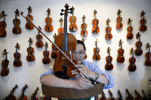 Francisco Kjolseth  |  The Salt Lake Tribune Charles Liu has been making fine violins in Salt Lake for years and hosts the Stradivarius International Violin Competition. From a small space at 7450 South State that used to be a house, Liu has built a business that caters to those just starting out to the most gifted professional, illustrated by the student violins on the wall that cost a few hundred dollars to the one held by Liu, a 1884 Italian Vincentius Postiglione and Sartory bow which combined cost about $180,000.