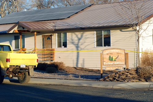 Crime scene tape surrounds the tribal headquarters of the Cedarville Rancheria Friday, Feb. 21, 2014 in Alturas, Calif., where police say an eviction hearing turned deadly as a woman who once served as a tribal leader allegedly opened fire, killing four people and critically wounding two others in a gun and knife attack. Cherie Lash Rhoades, a former chairwoman of Cedarville Rancheria, was taken into custody after the bloody attack at the tribal office Thursday afternoon, Alturas police chief Ken Barnes said in area media reports. (AP Photo/Jeff Barnard)