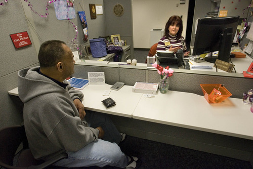 Paul Fraughton | The Salt Lake Tribune. Tammy Rider, an Individual Taxpayer Advisory Specialist, gives some tax advise to Sione Manu at the Taxpayer Assistance Center  in downtown Salt Lake City. Tax Day is less than two months away.