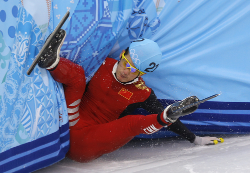 Liang Wenhao of China crashes out in the men's 500m short track speedskating final at the Iceberg Skating Palace during the 2014 Winter Olympics, Friday, Feb. 21, 2014, in Sochi, Russia. (AP Photo/Vadim Ghirda)
