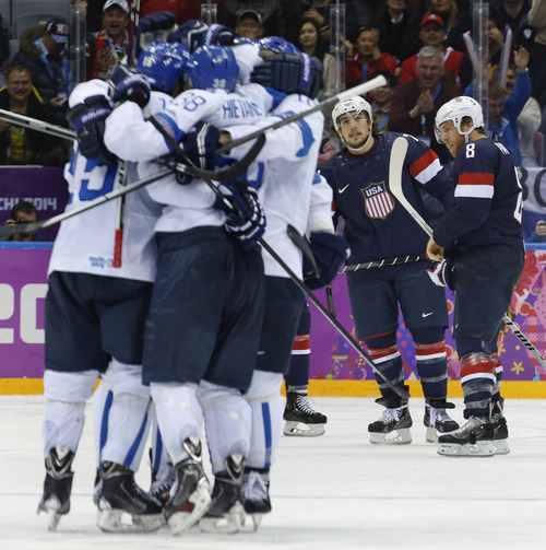USA defenseman Justin Faulk and forward Joe Pavelski react as Finland celebrates a goal during the third period of the men's bronze medal ice hockey game at the 2014 Winter Olympics, Saturday, Feb. 22, 2014, in Sochi, Russia. (AP Photo/Mark Humphrey)