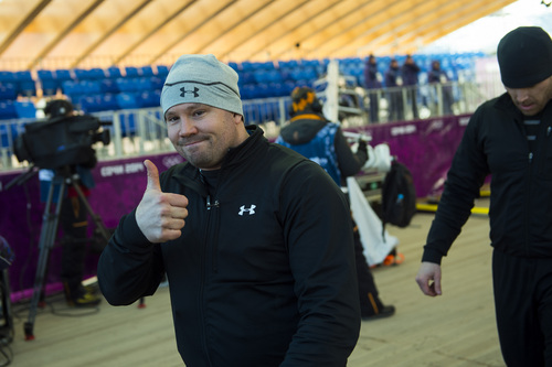 Chris Detrick     The Salt Lake Tribune  Bobsled athlete Steven Holcomb gives a thumbs up after a practice run at the Sanki Sliding Center in Rzhanaya Polyana, Russia, before the start of the 2014 Sochi Olympics Thursday February 6, 2014.