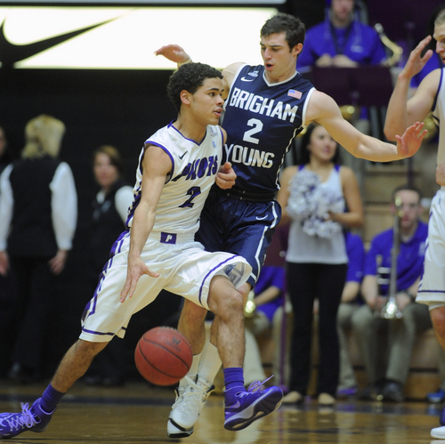 BYU's Matt Carlino (2) defends against Portland's Alec Wintering (2) during the first half of an NCAA college basketball game in Portland, Ore., Thursday Jan. 23, 2014. (AP Photo/Greg Wahl-Stephens)