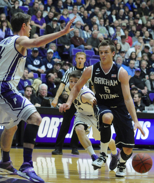 BYU's Kyle Collingsworth (5) drives against Portland's Thomas van der Mars (12) during an NCAA college basketball game in Portland, Ore., Thursday Jan. 23, 2014. (AP Photo/Greg Wahl-Stephens)