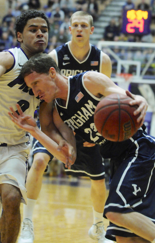 BYU's Skyler Halford (23) drives against Portland's Alec Wintering (2) during the first half of an NCAA college basketball game in Portland, Ore., Thursday Jan. 23, 2014. (AP Photo/Greg Wahl-Stephens)