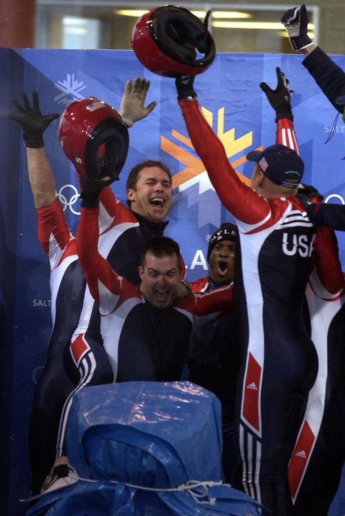 Trent Nelson  |  Tribune file photo Brian Shimer leaps up behind Mike Kohn as the two USA bobsled pilots realize they have each medaled during the 2002 Salt Lake Games. Shimer won bronze and Hays silver.