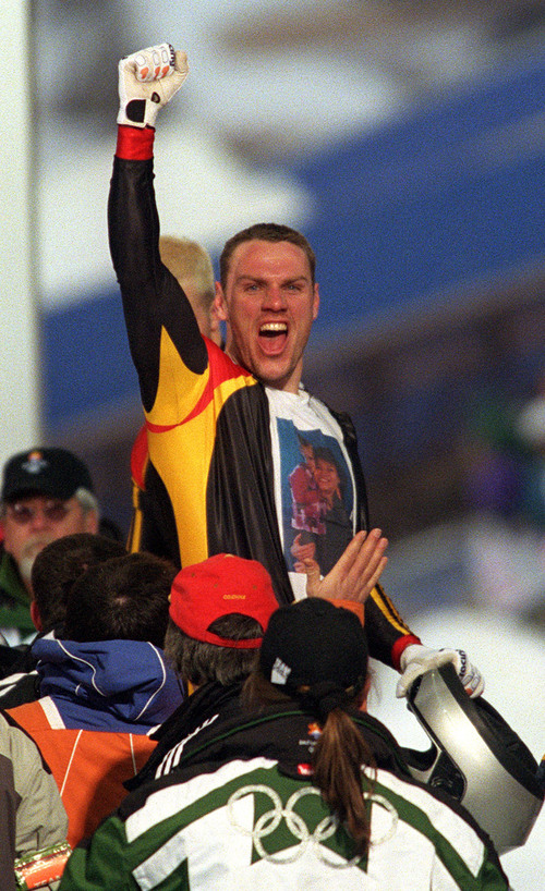 |  Tribune file photo  Carsten Embach of Team Germany celebrates after his team's final run of the four-man bobsled at the Utah Olympic Park during the 2002 Salt Lake Games. Germany won the gold medal.