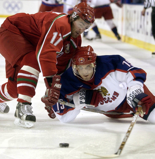 |  Tribune file photo  Belarus' Aleksei Kalyuzhny tries to keep Russia's Alexei Yashin away from the puck during the bronze medal game during the 2002 Salt Lake Games.