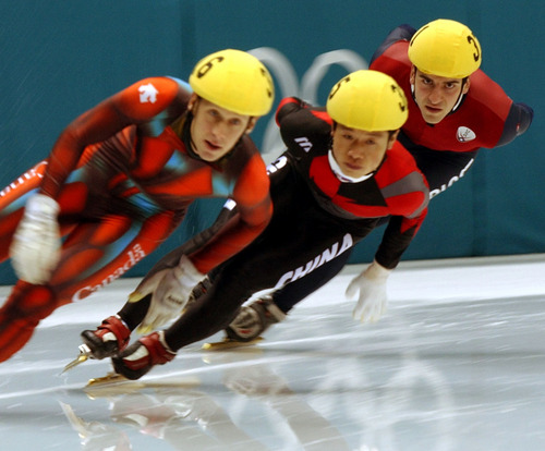 Rick Egan  |  Tribune file photo Canada's Jonathan Guilmette, from left, China's Ye Li, and USA's Daniel Weinstein race in the 5,000-meter relay during the 2002 Salt Lake Games.
