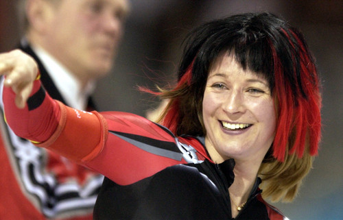 Steve Griffin  |  Tribune file photo Wearing a black and red wig, Claudia Pechstein, of Germany, smiles at the crowd after setting a world record and winning the gold medal in the women's 5,000 meters at the Utah Olympic Oval. Pechstein put the wig on for fun after she had finished her race during the 2002 Salt Lake Games.