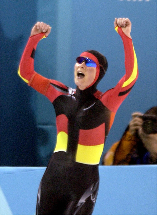 Steve Griffin  |  Tribune file photo Claudia Pechstein, of Germany, raises her arms after setting a world record in the women's 5,000 meters at the Utah Olympic Oval. Pechstein also won the gold medal in the event during the 2002 Salt Lake Games.