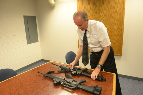 Rick Egan    The Salt Lake Tribune   Granite School District Police Chief Randy Johnson with one of the M-16s he received from the U.S. Department of Defense. Thursday, February 20, 2014.