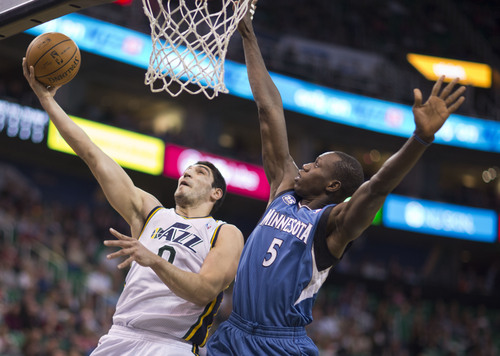 Lennie Mahler  |  The Salt Lake Tribune Utah Jazz Enes Kanter scores over Timberwolves Center Gorgui Dieng in the first half of a game Saturday, Feb. 22, 2014, in Salt Lake City.