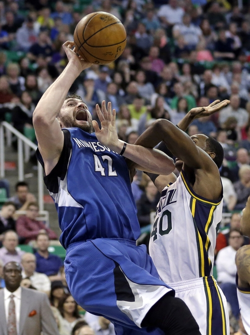 Minnesota Timberwolves' Kevin Love (42) is fouled by Utah Jazz's Jeremy Evans (40) in the second half of an NBA basketball game Saturday Feb. 22, 2014, in Salt Lake City. The Timberwolves won 121-104. (AP Photo/Rick Bowmer)