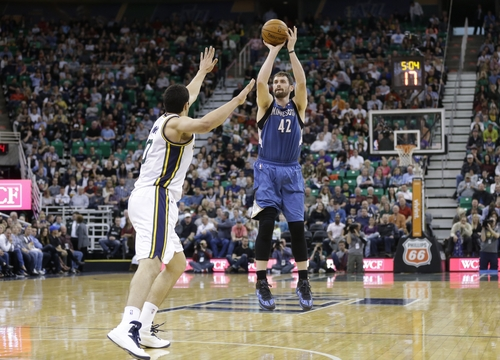 Minnesota Timberwolves' Kevin Love (42) shoots as Utah Jazz's Enes Kanter, left, defends in the second quarter of an NBA basketball game, Saturday, Feb. 22, 2014, in Salt Lake City. (AP Photo/Rick Bowmer)