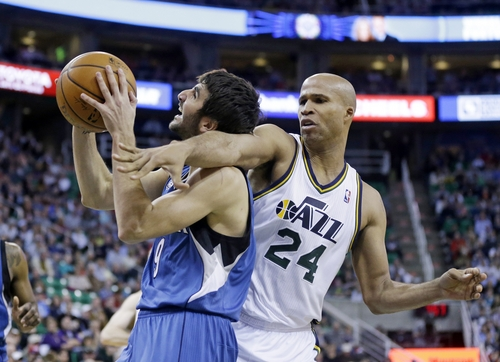 Minnesota Timberwolves' Ricky Rubio (9), of Spain, is fouled by Utah Jazz's Richard Jefferson (24) in the second quarter of an NBA basketball game Saturday Feb. 22, 2014, in Salt Lake City. (AP Photo/Rick Bowmer)