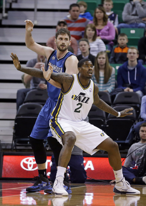 Utah Jazz's Marvin Williams (2) guards Minnesota Timberwolves' Kevin Love, left, in the first quarter of an NBA basketball game, Saturday, Feb. 22, 2014, in Salt Lake City. (AP Photo/Rick Bowmer)