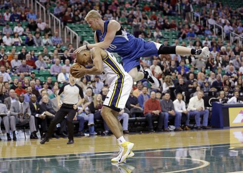 Minnesota Timberwolves' Chase Budinger (10) fouls Utah Jazz's Richard Jefferson (24) in the first quarter of an NBA basketball game, Feb. 22, 2014, in Salt Lake City. (AP Photo/Rick Bowmer)