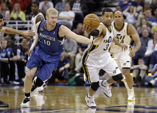 Utah Jazz's Trey Burke (3) steals the ball from Minnesota Timberwolves' Chase Budinger (10) in the first quarter of an NBA basketball game Feb. 22, 2014, in Salt Lake City. (AP Photo/Rick Bowmer)