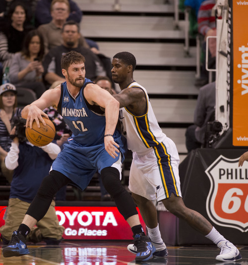 Lennie Mahler  |  The Salt Lake Tribune Timberwolves forward Kevin Love posts up against Jazz forward Marvin Williams in the first half of a game Saturday, Feb. 22, 2014, in Salt Lake City.