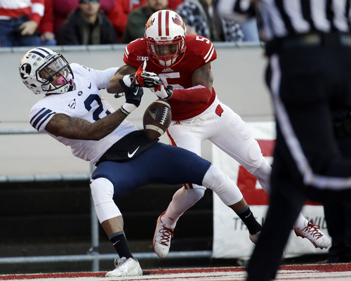 Wisconsin's Darius Hillary (5) breaks up a pass intended for Brigham Young's Cody Hoffman during the first half of an NCAA college football game on Saturday, Nov. 9, 2013, in Madison, Wis. (AP Photo/Morry Gash)