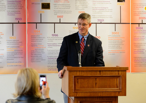 Trent Nelson  |  The Salt Lake Tribune Rep. Tim Cosgrove speaks before a fifteen foot long timeline of progress as state officials and others celebrated 30 years of violence and injury prevention in Utah, Thursday November 14, 2013.