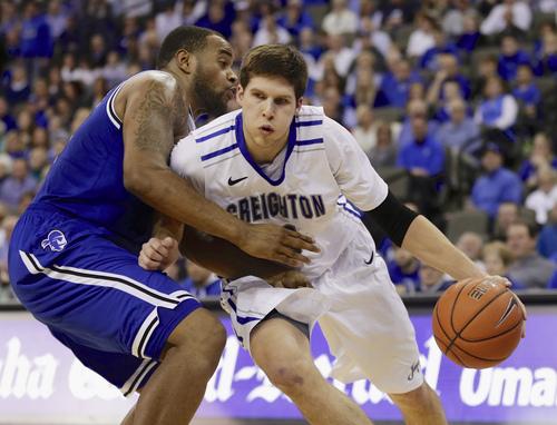 Creighton's Doug McDermott, right, drives around Seton Hall's Eugene Teague, left, in the second half of an NCAA college basketball game in Omaha, Neb., Sunday, Feb. 23, 2014. Creighton won 72-71. (AP Photo/Nati Harnik)