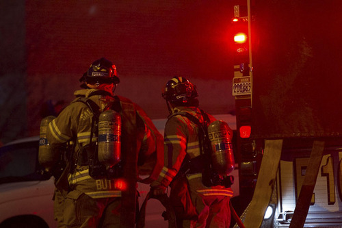 Courtesy  |  Bryce Packham Firefighters respond to the four-alarm fire in Salt Lake City, Sunday, Feb. 9, 2014.