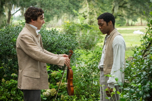 """This film publicity image released by Fox Searchlight shows Benedict Cumberbatch, left, and Chiwetel Ejiofor in a scene from """"12 Years A Slave."""" The film, by director Steve McQueen, is being hailed a masterpiece and a certain Oscar heavyweight. (AP Photo/Fox Searchlight Films, Jaap Buitendijk)"""