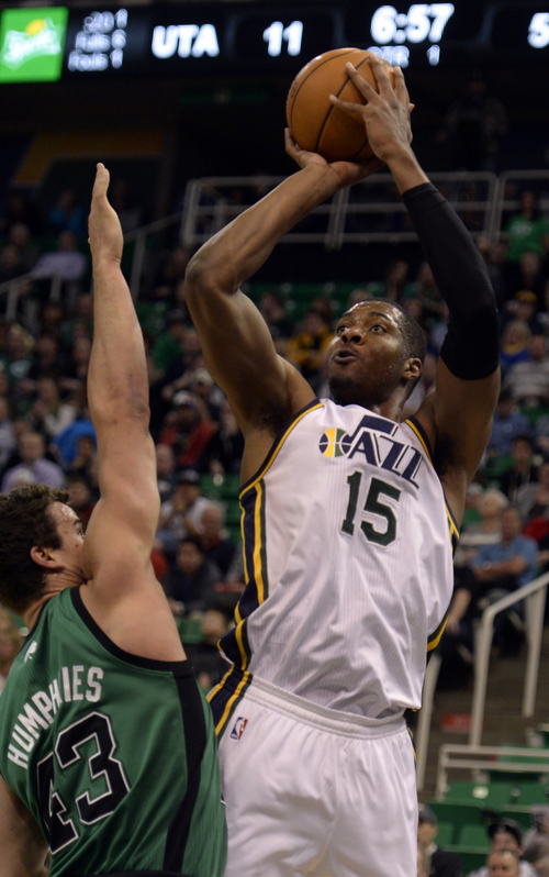 Rick Egan  | The Salt Lake Tribune   Utah Jazz center Derrick Favors (15) shoots overBoston Celtics center Kris Humphries (43), in NBA action, at the EnergySolutions Arena, Monday, February 24, 2014.