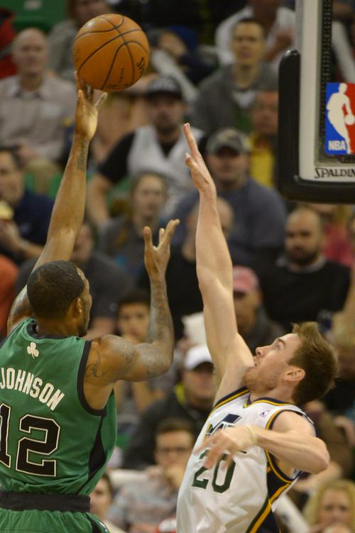 Rick Egan    The Salt Lake Tribune   Boston Celtics small forward Chris Johnson (12) takes a shot over Utah Jazz shooting guard Gordon Hayward (20), in NBA action, at the EnergySolutions Arena, Monday, February 24, 2014.