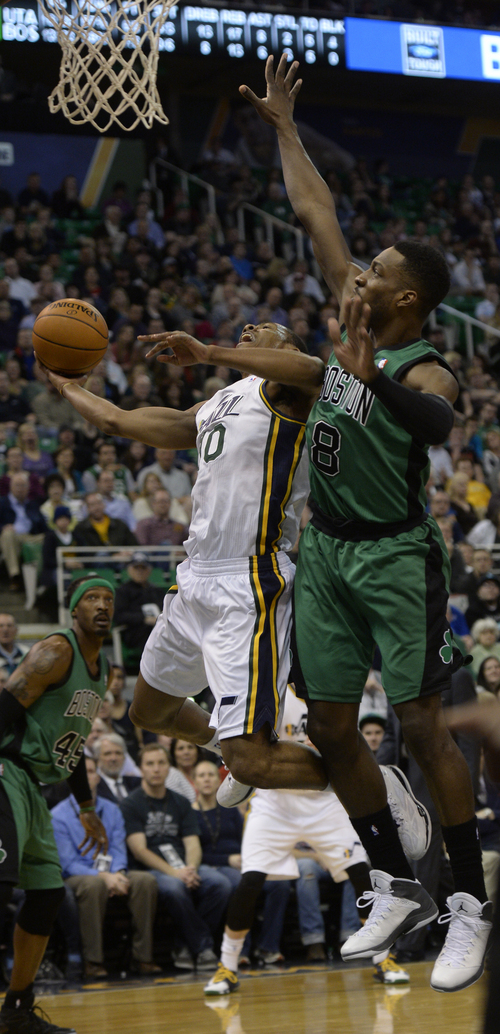 Rick Egan  | The Salt Lake Tribune   Utah Jazz point guard Alec Burks (10) shoots over Boston Celtics small forward Jeff Green (8) in NBA action, at the EnergySolutions Arena, Monday, February 24, 2014.