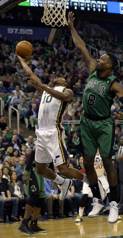 Rick Egan  | The Salt Lake Tribune   Utah Jazz point guard Alec Burks (10) shoots asBoston Celtics small forward Jeff Green (8) defends, in NBA action, at the EnergySolutions Arena, Monday, February 24, 2014.