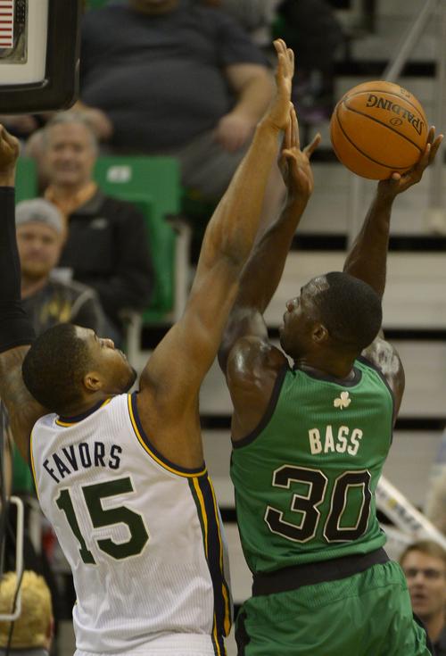 Rick Egan    The Salt Lake Tribune   Utah Jazz center Derrick Favors (15) blocks a shot by Boston Celtics power forward Brandon Bass (30), in NBA action, at the EnergySolutions Arena, Monday, February 24, 2014.