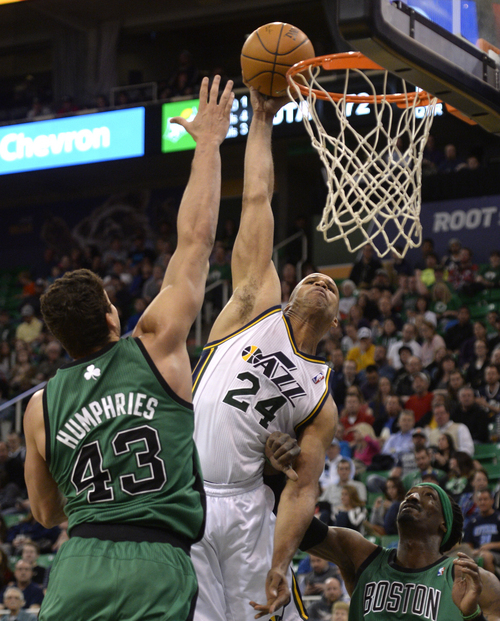 Rick Egan  | The Salt Lake Tribune   Utah Jazz small forward Richard Jefferson (24) dunks the ball over Boston Celtics center Kris Humphries (43), in NBA action, at the EnergySolutions Arena, Monday, February 24, 2014.