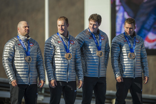 KRASNAYA POLYANA, RUSSIA  - JANUARY 23: USA's Steven Holcomb, Chris Fogt, Curtis Tomasevicz, and Steve Langton, celebrate during the medal ceremony at the finish of the four-man bobsled at Sanki Sliding Center during the 2014 Sochi Olympics Sunday February 23, 2014. They won the bronze medal with a cumulative time of 3:40.99.  (Photo by Chris Detrick/The Salt Lake Tribune)
