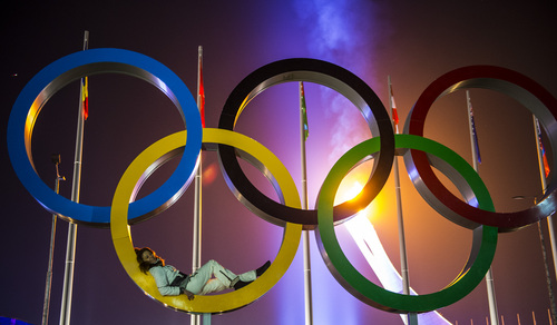 SOCHI, RUSSIA  - JANUARY 23: A woman poses for pictures with the Olympic rings and flame during the Closing Ceremony of the 2014 Sochi Olympics at Fisht Olympic Stadium Sunday February 23, 2014.  (Photo by Chris Detrick/The Salt Lake Tribune)