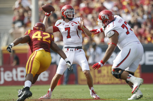 Chris Detrick  |  The Salt Lake Tribune Utah Utes quarterback Travis Wilson (7) passes the ball past USC Trojans linebacker Devon Kennard (42) during the first half game at the The Los Angeles Memorial Coliseum Saturday October 26, 2013. USC is winning the game 16-3.
