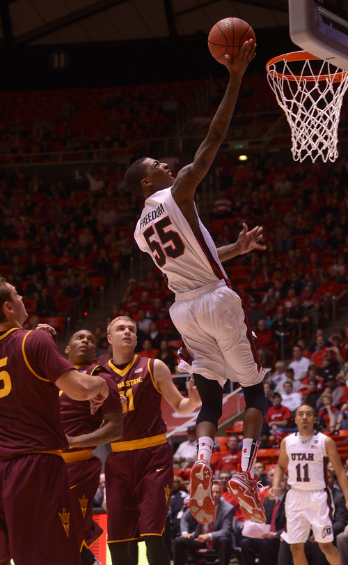 Leah Hogsten  |  The Salt Lake Tribune Utah Utes guard Delon Wright (55) skies unguarded to the net. University of Utah defeated Arizona State 86-63 Sunday, February 23, 2014, at the Jon M. Huntsman Center.