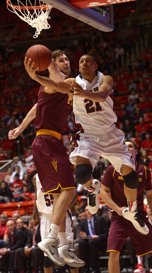 Leah Hogsten  |  The Salt Lake Tribune Utah Utes forward Jordan Loveridge (21) hits the net around Arizona State Sun Devils center Jordan Bachynski (13). University of Utah defeated Arizona State 86-63 Sunday, February 23, 2014, at the Jon M. Huntsman Center.