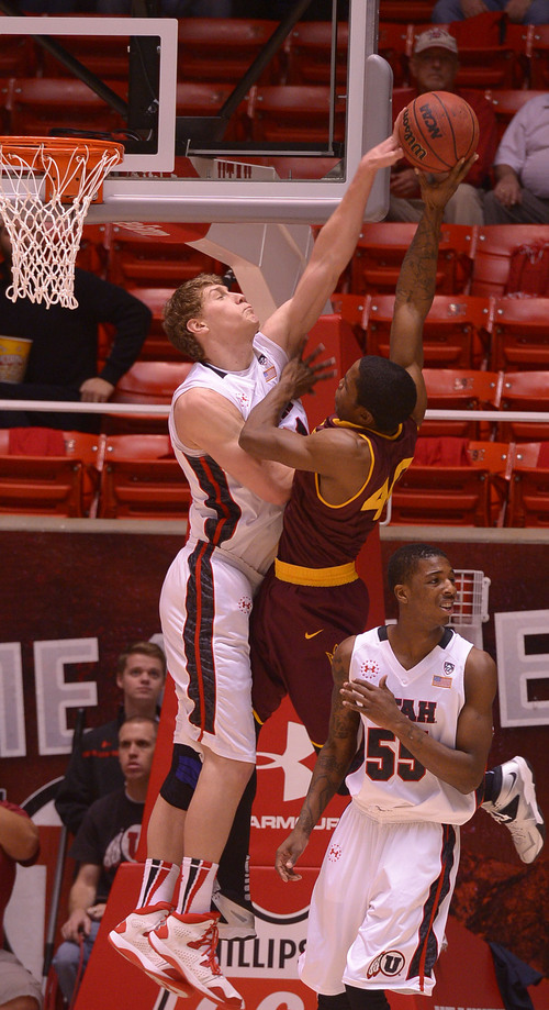 Leah Hogsten  |  The Salt Lake Tribune Utah's Dallin Bachynski,left, blocks the shot of Arizona State's Shaquielle McKissic during the Utes' easy victory Sunday at the Hunstman Center.