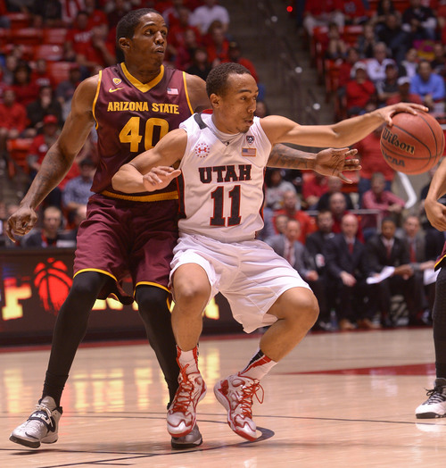 Leah Hogsten  |  The Salt Lake Tribune Utah's Brandon Taylor  runs into Arizona State's Shaquielle McKissic  for the turnover Sunday night at the Huntsman Center. Taylor finished with 9 points as the Utes crushed the Sun Devils 86-63.
