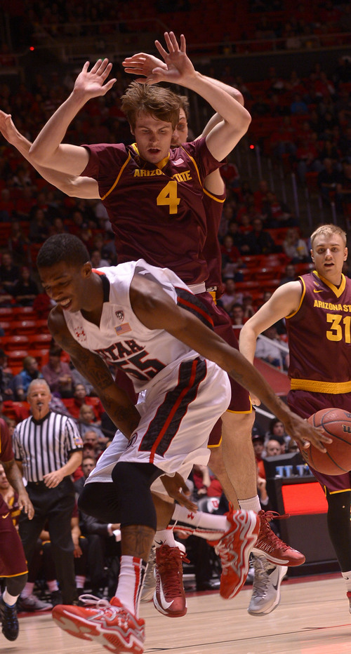Leah Hogsten  |  The Salt Lake Tribune Utah Utes guard Delon Wright (55) is fouled by Arizona State Sun Devils guard Bo Barnes (4). University of Utah leads Arizona State 51-26 at the half Sunday, February 23, 2014, at the Jon M. Huntsman Center.