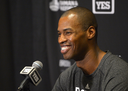 Brooklyn Nets center Jason Collins speaks during a news conference prior to an NBA basketball game against the Los Angeles Lakers, Sunday, Feb. 23, 2014, in Los Angeles. Collins is set to become the NBA's first active openly gay player. He signed a 10-day contract with the Brooklyn Nets earlier Sunday and was to be in uniform for their game in Los Angeles against the Lakers. The 35-year-old center revealed at the end of last season he is gay, but he was a free agent and had remained unsigned. (AP Photo/Mark J. Terrill)