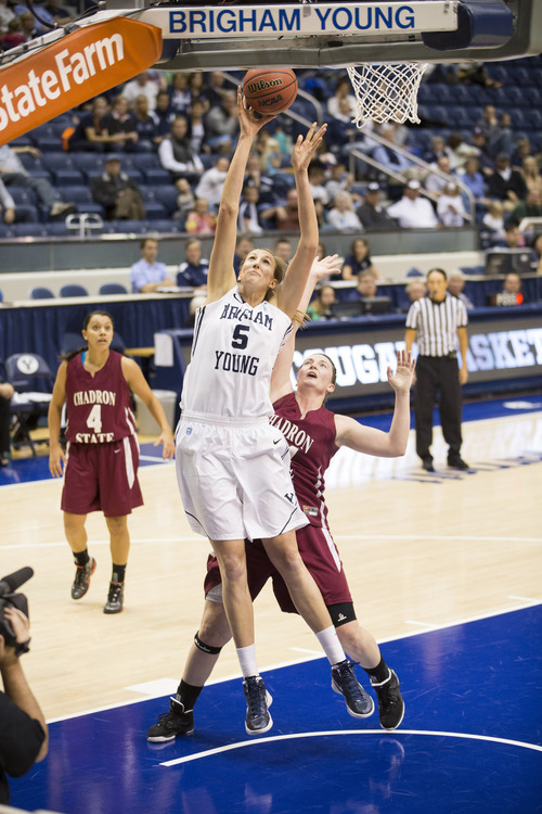 BYU volleyball and basketball star Jennifer Hamson is on the radar of WNBA teams, and could get drafted next month. But Hamson has committed to one final volleyball season with the Cougars. BYU courtesy photo.