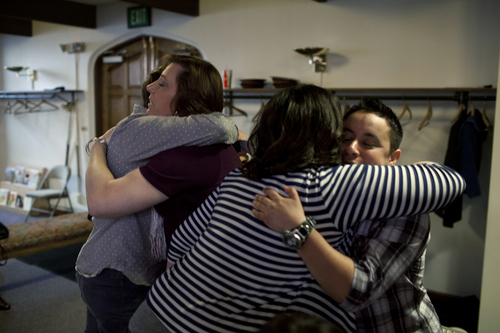 Jim McAuley  |  The Salt Lake Tribune Panel experts Rachel Heller, left, and Alex Florence, right, hug participants after the Transgender 101 workshop at the 22nd Circling the Wagons conference, a conference designed to build understanding between LGBT Mormons and members of the LDS Church, at Wasatch Presbyterian Church in Salt Lake City on Saturday.