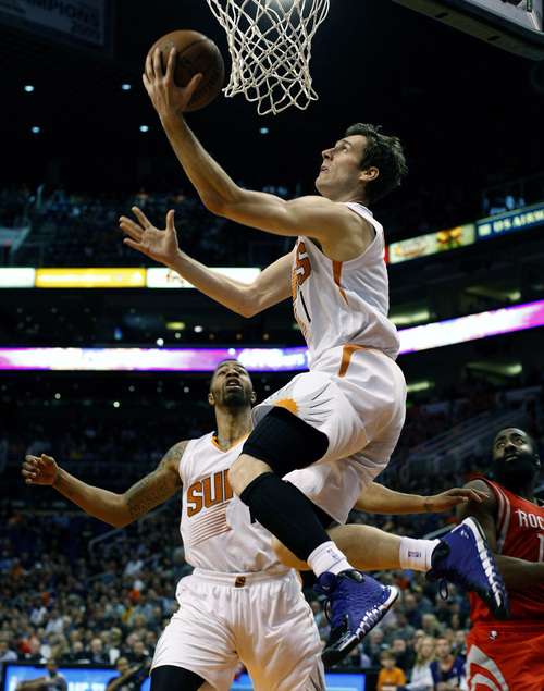 Phoenix Suns shooting guard Goran Dragic (1) scores against the Houston Rockets during an NBA basketball game, Sunday, Feb. 23, 2014, in Phoenix. (AP Photo/Rick Scuteri)