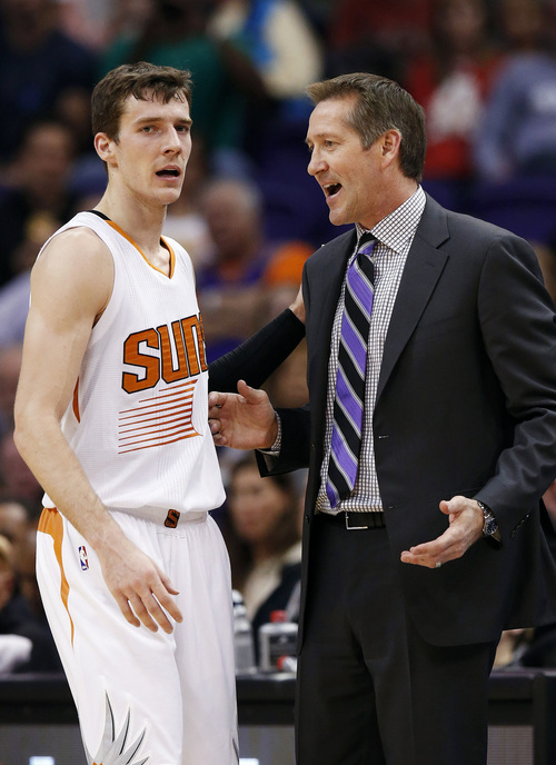 Phoenix Suns' Jeff Hornacek, right, talks with Goran Dragic, left, of Slovenia, during the first half of an NBA basketball game against the Golden State Warriors, Saturday, Feb. 8, 2014, in Phoenix. (AP Photo/Ross D. Franklin)